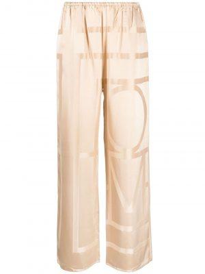 Toteme logo-printed silk trousers